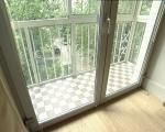 Распашные двери на французский балкон